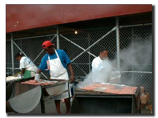 Picture of cooks making hamburgers