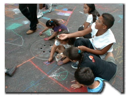 Picture of children enjoying themselves drawing on the street
