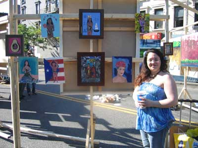 New upcoming artist, Linda Alicea poses next to her art