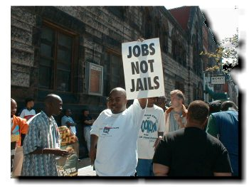 "Picture of participant holding up sign which read ""Jobs not Jails"""