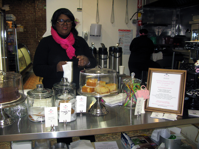 Inside view of Aromas showing Owner Jo-Ann Barett.