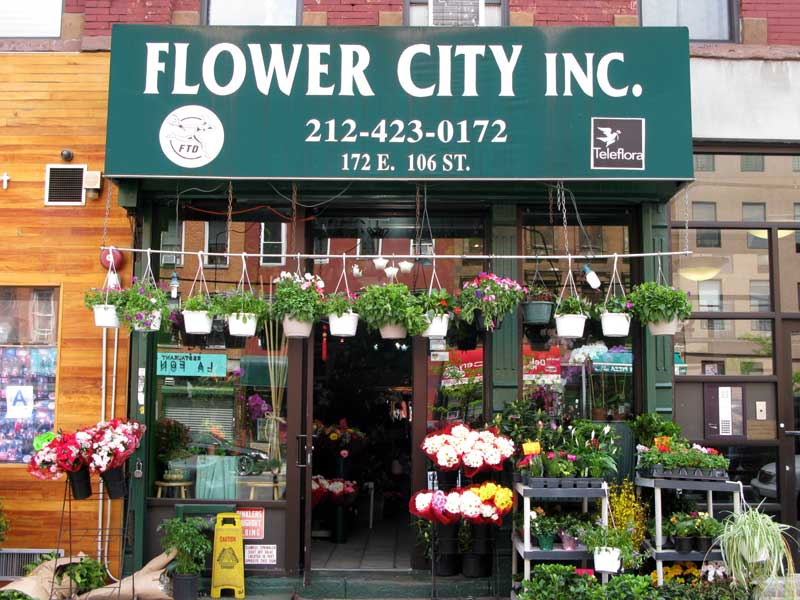 Photo of the outside of Flower City as seen from the street level.