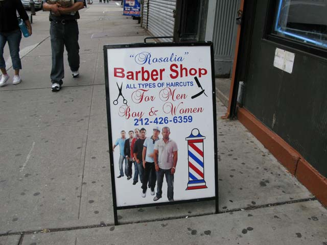 Photo of the sign outside Rosalia's Barber Shop