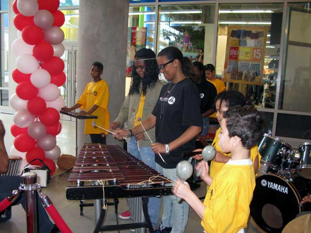 Speaking in Rhythms Inc student play their musical instruments.