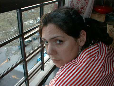 Picture of my wife Cecilia looking out the window