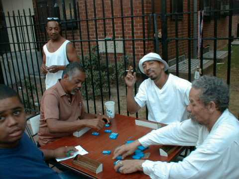 Another picture of resident playing dominoes