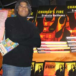 Photo of Ernesto Quinonez in the forferont with enlarged photo of his new book in the background