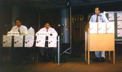 John Rivera moderating assembly candidates' debate 1996