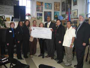La Casa De La Herencia Cultural Puertorriquena receives a check for 225K from Mr. Kenneth Knuckles, President and CEO of the Upper Manhattan Empowerment Zone.