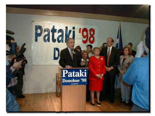 Picture of Fomer Congressman Herman Badillo, State Senator Olga Mendez and Governor George Pataki standing before the crowd