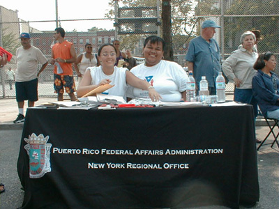 Picture of the Representatives of the Puerto Rico Federal Affairs Administration, who were on hand with helpful information.