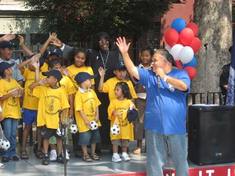 Neighborhood children pledging with Reverend Gilberto Lopez, clergy liaison for the 23rd Precinct, on September 8, 2007 to continue the legacy of the fallen heroes of 9-11 by living a positive life and making a difference in their community