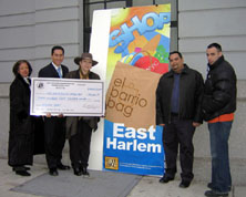 Photo of Ms. Elizabeth Colon receiving ceremonial check from the Upper Manhattan Empowerment Zone